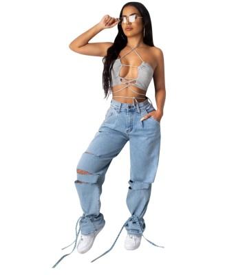 Jeans strappati con fondo annodato a vita alta azzurri
