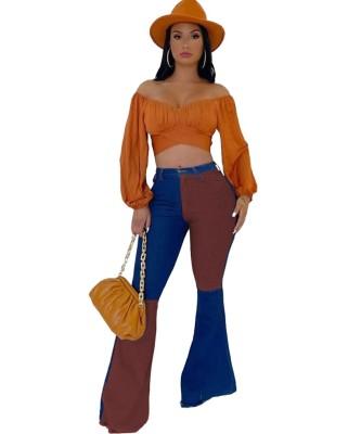 Jeans svasati a vita alta a contrasto alla moda