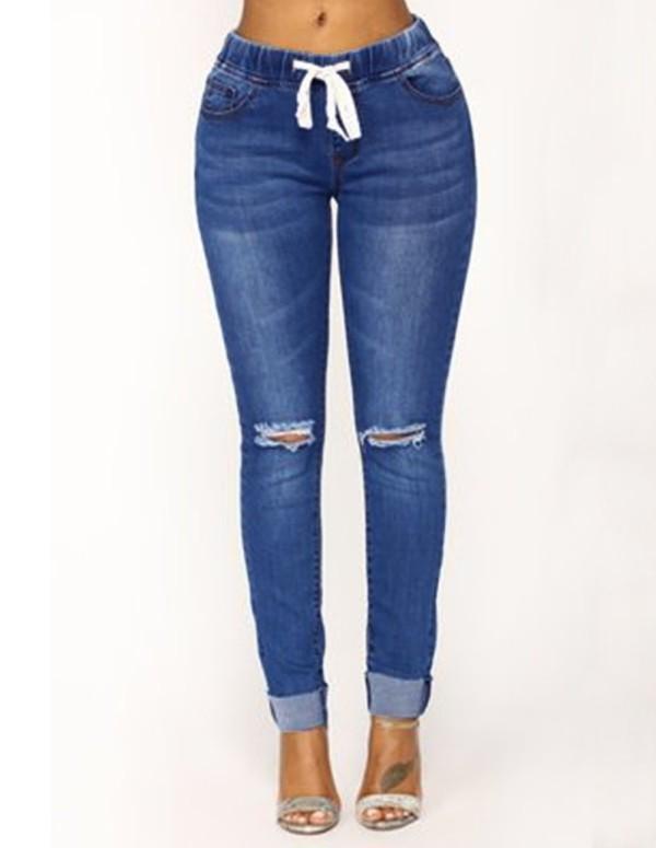 Jeans regulares rasgados azules otoñales