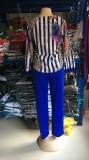 Conjunto de pantalón liso y blusa de leopardo maduro de talla grande