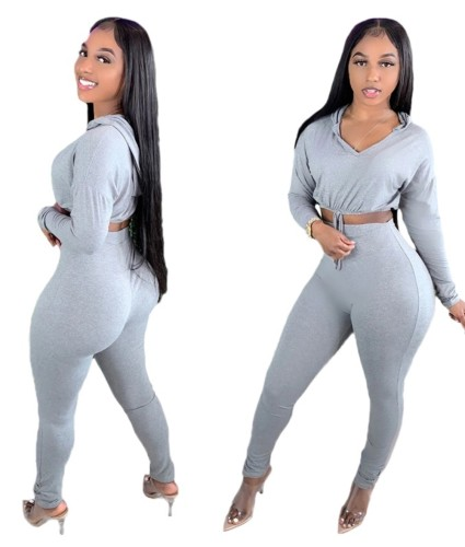 Conjunto de calça de cintura alta e top de corte com capuz liso liso outono sólido
