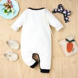 Pagliaccetti con bottoni bianchi con stampa autunnale per neonata