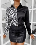 Elegante Bluse mit weißem und schwarzem Herbstdruck