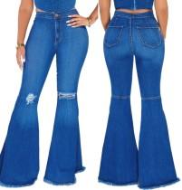 Jeans acampanados rasgados de cintura alta azul otoño