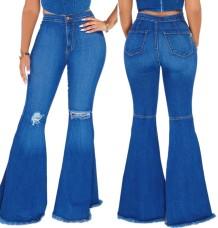 Осенние синие рваные расклешенные джинсы с высокой талией