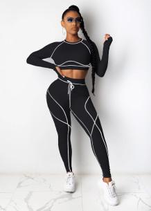 Top corto e legging per il fitness sportivo autunnale
