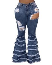 Осенние стильные расклешенные джинсы с вырезом и кисточками