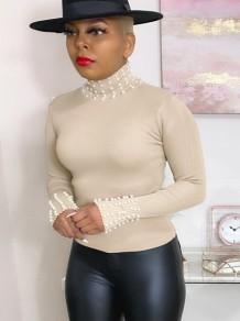 Top básico de tricô com strass de gola alta