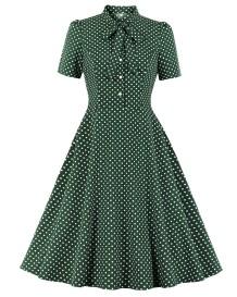 Зеленое винтажное платье с плиссированной юбкой в горошек с завязками спереди