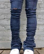 Jeans rasgados de cintura alta azul oscuro de otoño