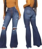 Jeans acampanados rasgados de cintura alta con lavado azul de invierno