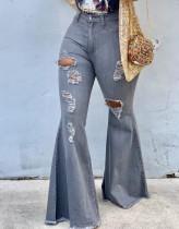 Winterblaue, verwaschene, zerrissene Flare-Jeans mit hoher Taille