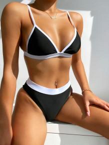 Tweedelige badkleding met contrasterende bandjes en hoge taille