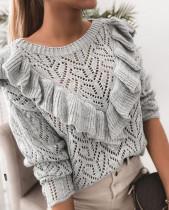 Suéter gris de primavera con volantes ahuecados