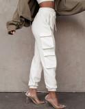 Pantalones deportivos casuales con bolsillos y cordones de color liso