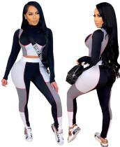 Top corto aderente sexy e pantaloni abbinati a colori a contrasto 2PC