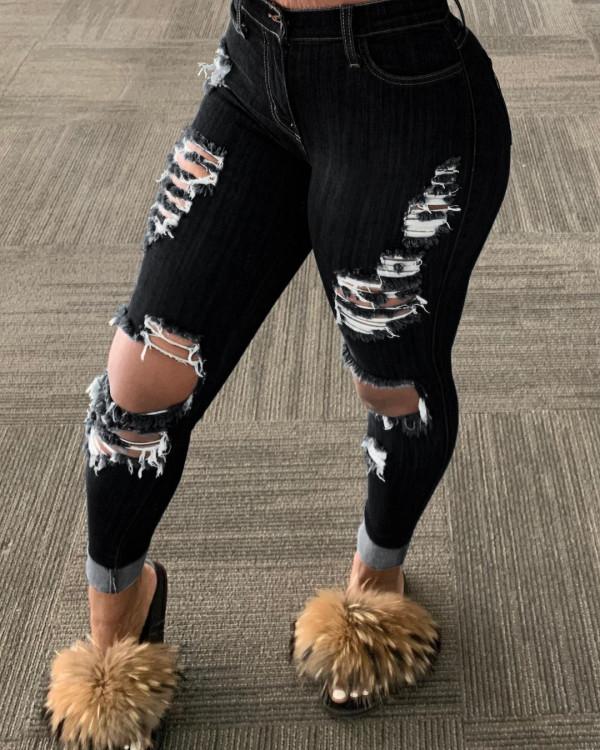 Vaqueros negros de corte sexy rotos