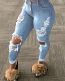 Jeans rasgados celestes de corte sexy