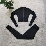 Conjunto casual de pantalón y top corto rasgado de dos piezas