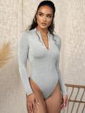 Body liso liso de manga larga y corte alto con cremallera