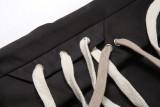 Pantalones deportivos casuales con cordones en blanco y negro