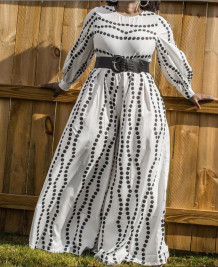 Macacão formal de manga comprida de ponto preto e branco plus size