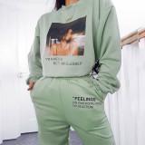 Pantalones deportivos con estampado de letras y bolsillos