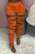 Pantaloni stretti a vita alta arancione estivi