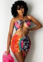 Top corto con scollo all'americana colorato con stampa estiva e minigonna abbinata con arricciatura