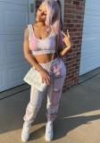 Set reggiseno sportivo e pantaloni sportivi abbinati rosa con stampa estiva
