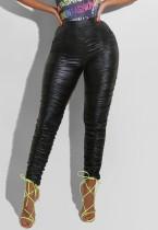 Pantaloni estivi in pelle nera con arricciatura a vita alta