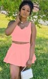 Top corto rosa casual estivo e minigonna a pieghe
