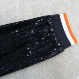 Top corto e pantaloni aderenti con lacci in due pezzi neri con paillettes estive