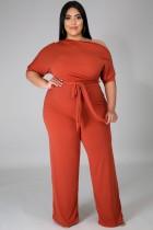 Tuta formale estiva con spalla tagliata arancione taglie forti