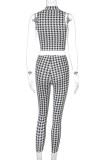 Bijpassende zomerse tweedelige crop top met zwarte en witte print en broek
