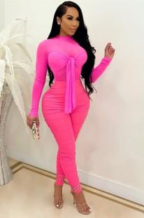 Tuta aderente annodata manica lunga sexy rosa estiva