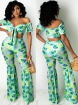 Top corto senza spalline verde con stampa estiva e pantaloni svasati 2 pezzi