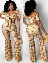 Top corto senza spalline giallo con stampa estiva e pantaloni svasati 2 pezzi