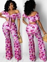 Top corto senza spalline rosa con stampa estiva e pantaloni svasati 2 pezzi