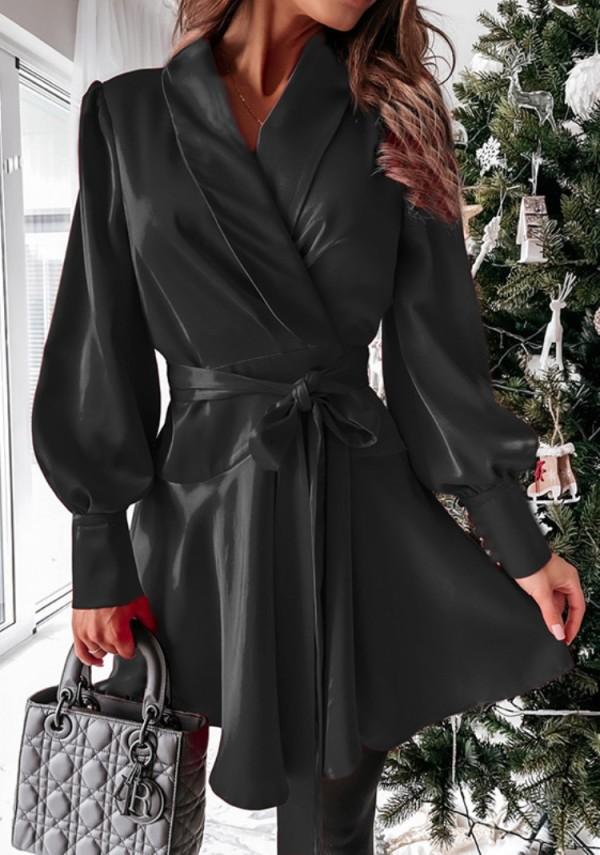 Lente-casual zwarte skaterjurk met pofmouwen en riem