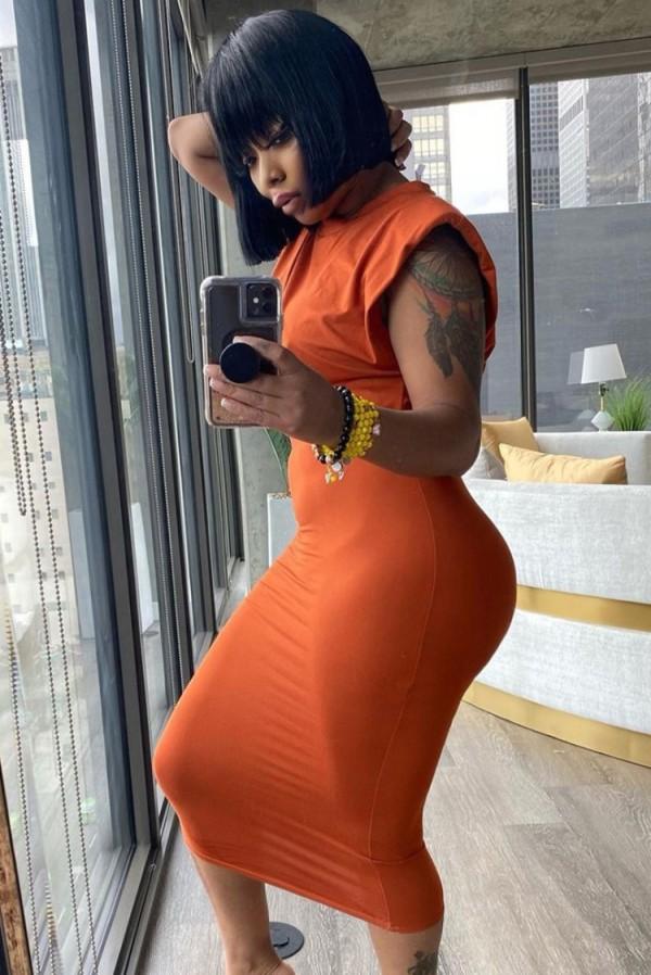 Conjunto de falda lápiz y top corto sexy naranja formal de verano
