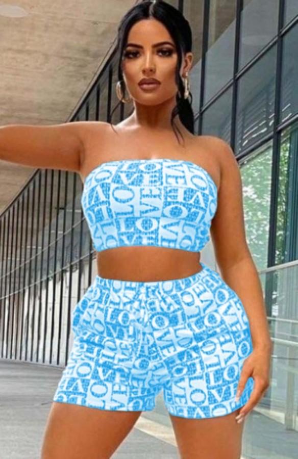 Conjunto de pantalones cortos y top corto sin tirantes azul con estampado de verano