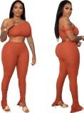 Top corto e pantaloni aderenti sexy arancione di estate