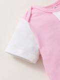 Tutina rosa con stampa estiva da bambina