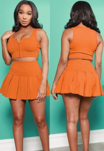 Ensemble gilet à glissière orange et jupe plissée pour sports d'été
