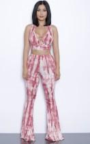 Completo estivo con top corto e pantaloni con lacci rosa tie dye