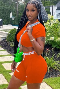Completo da 2 pezzi con top corto attillato sexy con stampa estiva arancione e pantaloncini da motociclista