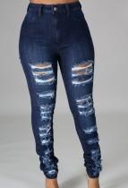 Zerrissene Blue Jeans mit hoher Taille im Sommer