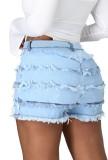 Pantalones cortos de mezclilla rasgados azul claro de cintura alta de verano