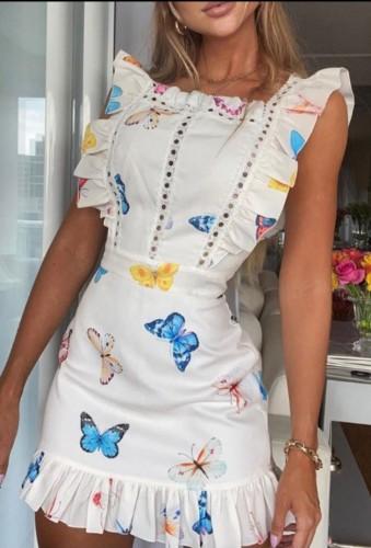 Mini-robe blanche d'été à volants et imprimé papillon